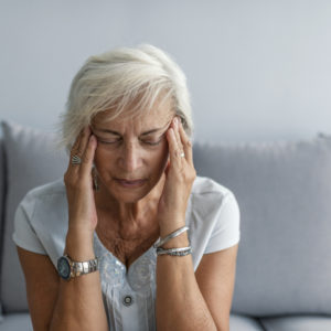 woman having migraine